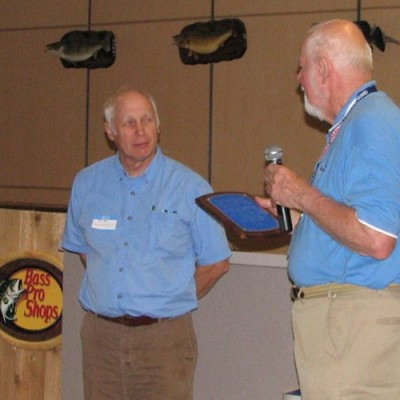 John Ruska presenting the 2012 Fran Hanes Award to Jim Engelbrecht.