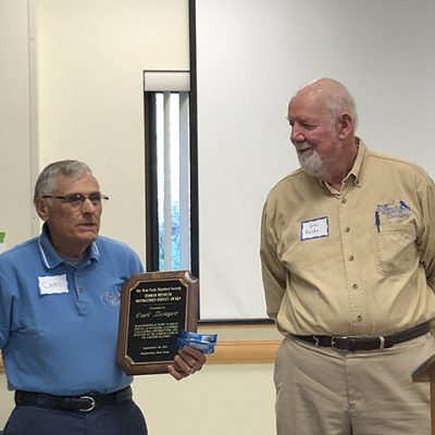 John Ruska (right) presents the 2019 Bressler award to Carl Zenger (left)