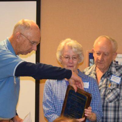 Bill Zitek presents the Bressler award to Norm and Phyllis Frey