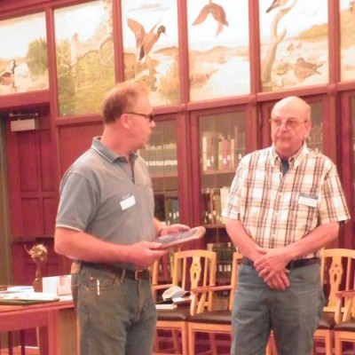 Rich Wells presenting the 2011 Fran Hanes Award to Henry Robie